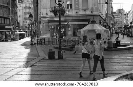 A Black And White Picture Of Walking Area In The City