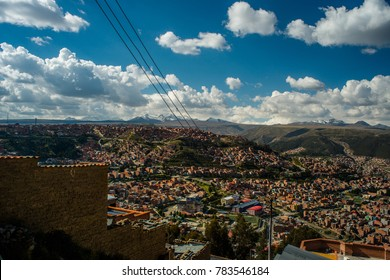 City and mountain view of La Paz, the city in Bolivia. A viewpoint mirador at the 16 de Julio Mi Teleférico station. Cable cars and houses among the mountains ranges.