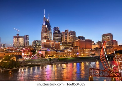 City of Nashville Tennessee at night on the Cumberland River in Tennessee USA