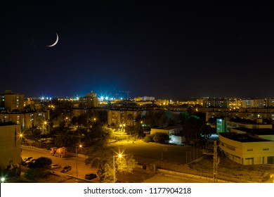 City neighborhood in Beer Sheba at evening with new moon