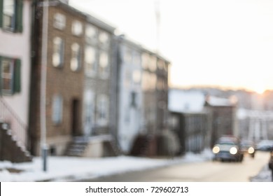 A city neighborhood at sunet. Image is intentionally blurred.