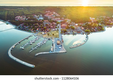City of Nida evening aerial view with yacht pier and surrounding forests in Curonian spit, Lithuania