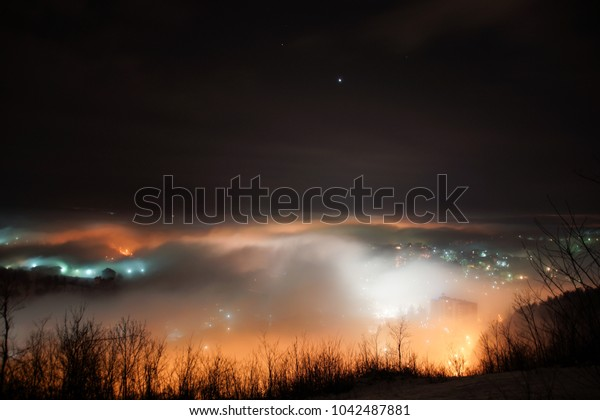 City in night covered by the fog