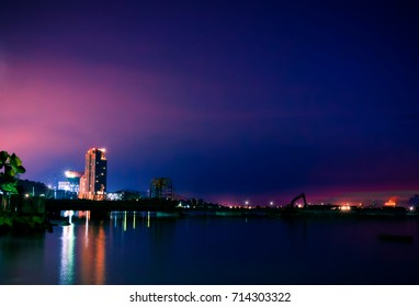 City night with sea scape background