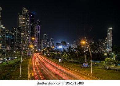 city at night, street traffic with modern skyscraper skyline -
