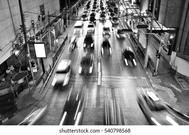 City night traffic, Blur traffic motion and car lights in rush hour background. (Black & White)