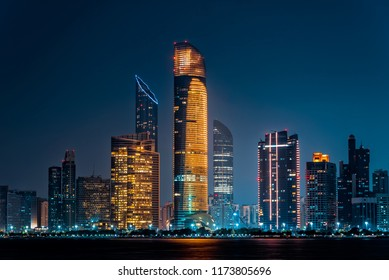City night view of Abu Dhabi business financial district. United Arab Emirates, middle east. Luxury lifestyle.
