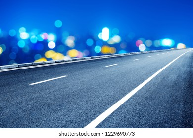 City night view, asphalt road in front of lights