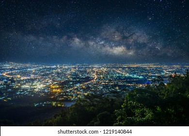 City night from the view point on top of mountain with milky way and stars field background , Chiang mai ,Thailand