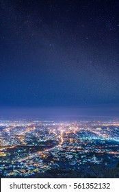 City night from the view point on top of mountain with close up detail from the milky way with stars field background  , Chiang mai ,Thailand