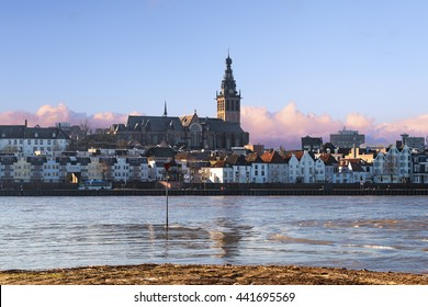 City of Nijmegen, Holland seen from across the river Waal with the Stevenskerk church against a beautiful morning sky