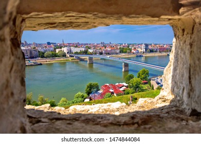 City Of Novi Sad and Danube river aerial view through stone window from Petrovaradin, Vojvodina region of Serbia