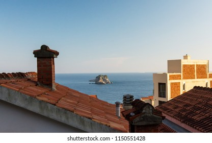 City on the mountain by the sea. The Mediterranean. Adriatic Sea, Montenegro. Petrovac.