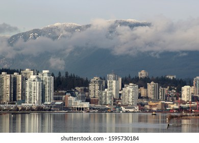 City on Water Front with Mountain Backdrop