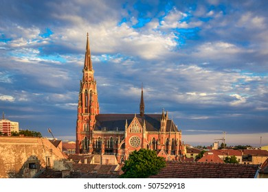 City of Osijek, Croatia, with cathedral of St Peter and Paul on a cloudy sunset.
