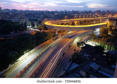 city overpass at night, circular flyover and traffic light intersection in bangladesh