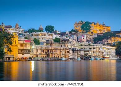 City Palace and Pichola lake at night, Udaipur, Rajasthan, India, Asia