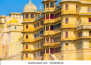 City Palace Udaipur Rajasthan India. It is located on the eastern banks of Pichola lake. The palace is a fusion of Rajasthani, European, Chinese and Mughal architecture.