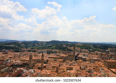 City panorama, aerila view, Florence, Tuscany, Italy; roofs, buildings, towers and hilly suburbs in the background.