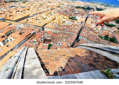 City panorama, aerila view, Florence, Tuscany, Italy; sightseeing - woman's hand with a pointed finger shows the landmarks.