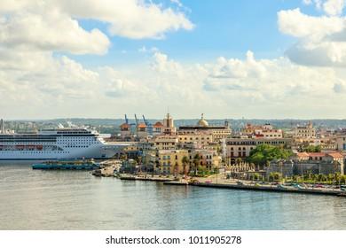 City panorama and big cruise ship docked in port of Havana, Cuba