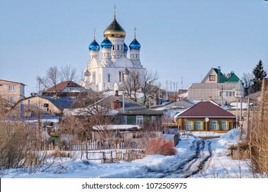 City panorama: Church and houses in the village in winter. Russia, Voronezh, Liski.