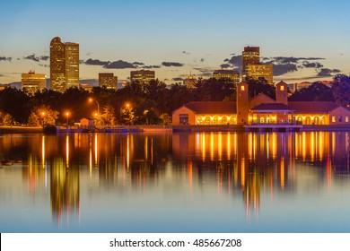 City Park at Dusk - A summer evening view of Ferril Lake in Denver City Park, with city skyline in the background, at east-side of Downtown Denver, Colorado, USA.