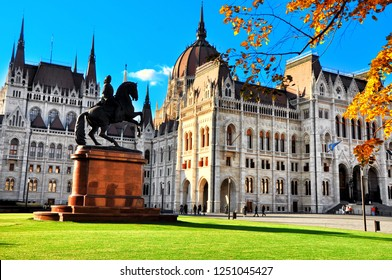City park with equestrian statue of Ferenc Rakoczi II in Parliament Square outside the Parliament Building built in Neo-Gothic style and located on the bank of Danube in Budapest Hungary,Europe