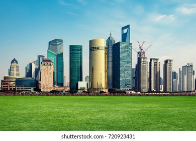 city park and modern financial buildings in shanghai