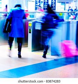 city people enter subway station