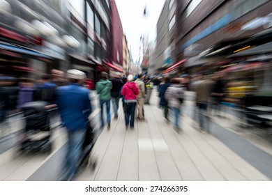 City people rushing on the street blurred motion