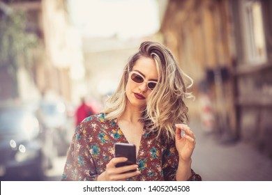 The city is perfect to be in a good connection. Woman in city using phone.