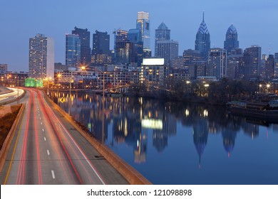 City of Philadelphia. Image of Philadelphia skyline, Schuylkill River and busy highway leading in to the city during sunset.