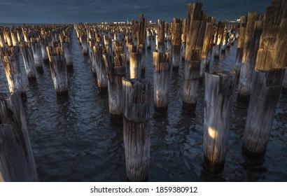 city pier sunrise Princes pier Port Melbourne wooden stumps reflections bay area