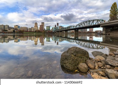 City of Portland Oregon skyline by Hawthorne Bridge reflected on Willamette River