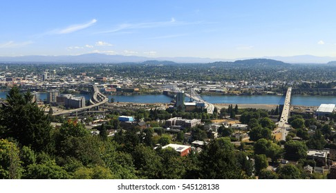 City of Portland - View of South Waterfront and East Portland as seen from Marquam Hill, west of the Willamette River. In view are Marquam Bridge, Tilikum Crossing, and Ross Island Bridge.
