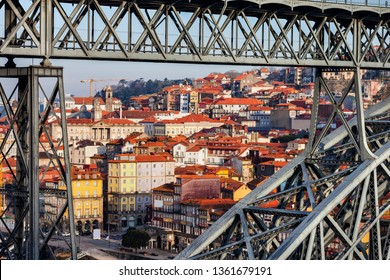 City of Porto in Portugal, view through the span of Dom Luis I Bridge to the Old Town
