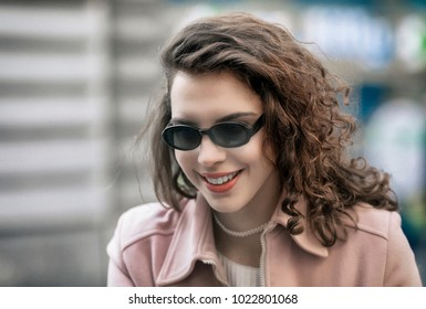 City portrait of happy young woman.