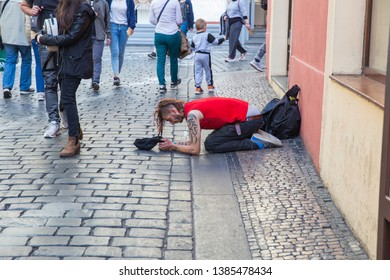 City Prague, Czech Republic. On the street the beggar  treats people for money. 2019. 24. April. Travel photo.