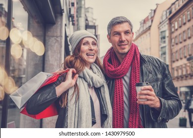 city present buying couple in autumn fall time