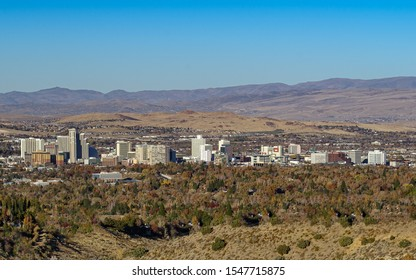 City of Reno, Nevada cityscape with hotels, casinos and a vibrant blue sky.