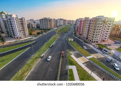 City residential building apartments with adjacent roads in aerial view at sunset. Photograph shot at Newtown Rajarhat area of Kolkata, India