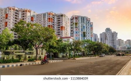 City residential multi storey apartments with adjacent road at sunrise. Photograph shot at Rajarhat area of Kolkata, India.