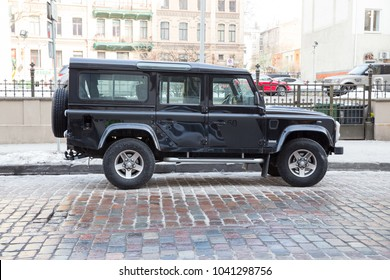 City Riga, Latvia, Land rover Jeep 4 x4 at street, urban city view. Blac car and winter day. 07.03.2017 Travel photo.
