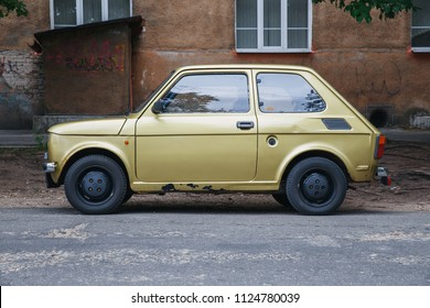 City Riga, Latvia. Retro Fiat 126 at street, gold color. Urban city view. 2018.