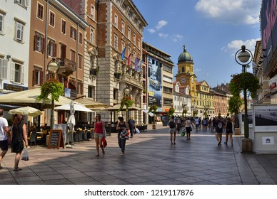 City of Rijeka, Istria, Croatia. August 2018. The civic tower or clock tower, yellow, is a landmark of the city. Walking along the korzo, the main pedestrian street, you immediately notice it.
