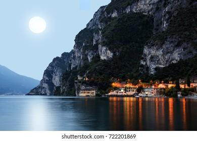 The city Riva del Garda by night. Garda lake in Northern Italy.