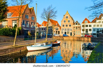 City river canal water reflection. River canal in city town. City river boat view. City river boat scene