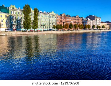 City river embankment panorama. Fontanka river water reflection in autumn. Autumn city river in Saint Petersburg, Russia. Fontanka river in autumn Saint Petersburg, Russia