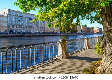 City river embankment scene. Autumn city river embankment in Saint-Petersburg, Russia. Autumn Fontanka river embankment view. Autumn city river embankment scene